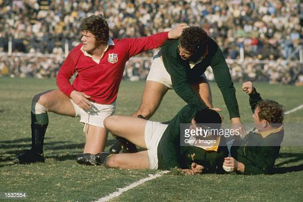 Fran Cotton of the British Lions hands off his opponent during the British Lions tour match against South Africa In South Africa Mandatory Credit...