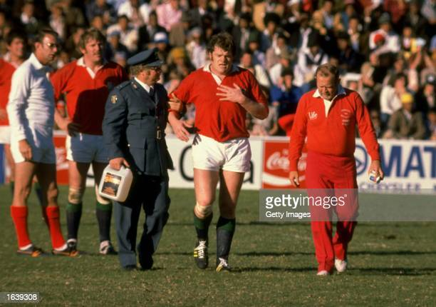 Fran Cotton of the British Lions is walked off following a heart attack during the Rugby Lions tour of South Africa South Africa Mandatory Credit...