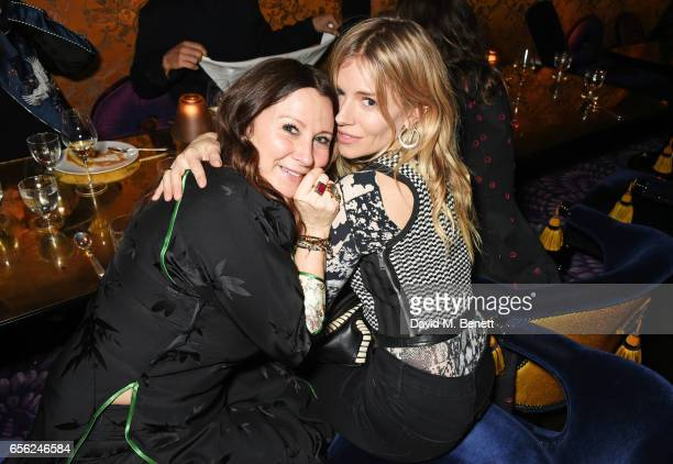 Fran Cutler and Sienna Miller attend the Another Man Spring/Summer Issue launch dinner in association with Kronaby at Park Chinois on March 21 2017...