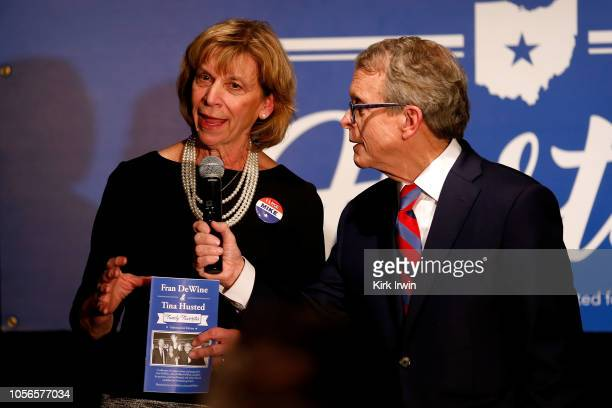 Fran DeWine wife of Republican Gubernatorial Candidate Ohio Attorney General Mike DeWine encourages people to take a cookbook that she wrote with...