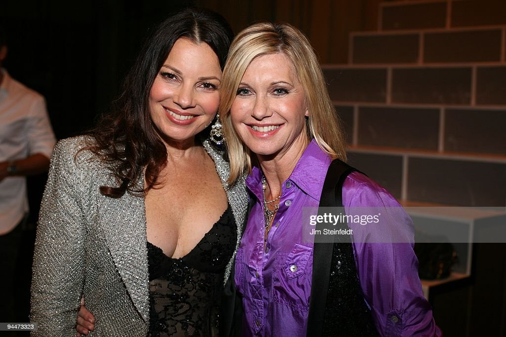Fran Drescher and Olivia Newton-John pose for a portrait at the Cancer Schmancer Rock Comedy benefit for 'I HEART INC' at the Million Dollar Theater in Los Angeles, California on December 13, 2009.
