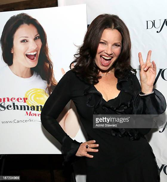 Fran Drescher celebrates her Cancer Schmancer Movement with DuJour's Jason Binn and SEN's Tora Matsuoka on November 6, 2013 in New York City.