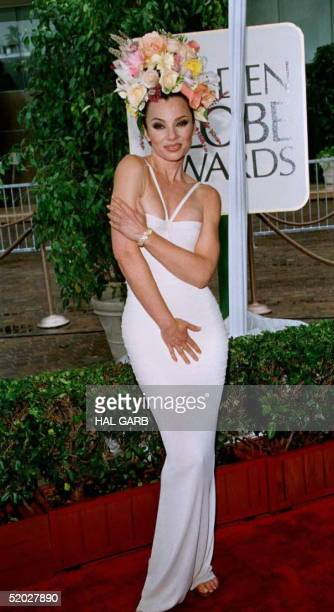 Fran Drescher who stars on the TV show 'The Nanny' poses for photographers as she arrives for the 53rd Annual Golden Globe Awards 21 January in...