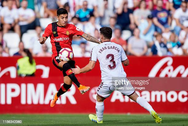 Fran García of Albacete competes for the ball with Leo Suarez of Mallorca during the LaLiga 123 match between Albacete and Mallorca at Carlos...