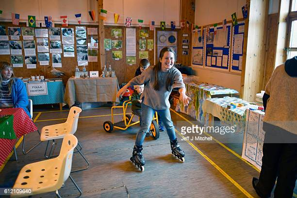 Fran Greartrys out a pair of roller blades during the primary school coffee morning on the Island of Foula on September 30 2016 in Foula Scotland...