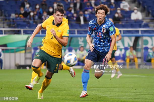 Fran Karacic of Australia and Yuya Osako of Japan compete for the ball during the FIFA World Cup Asian qualifier final round Group B match between...