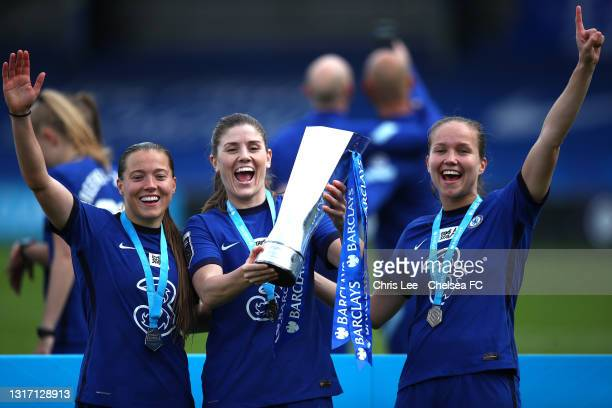 Fran Kirby, Maren Mjelde and Guro Reiten of Chelsea celebrate with the Barclays FA Women's Super League Trophy after the Barclays FA Women's Super...