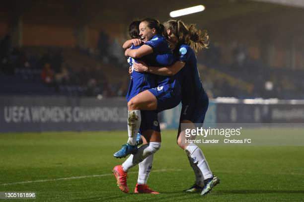 Fran Kirby of Chelsea celebrates with teammates Sam Kerr and Niamh Charles after scoring her team's second goal during the Women's UEFA Champions...