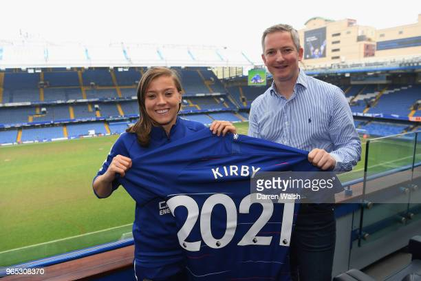 Fran Kirby of Chelsea FC Women Paul Green with poses as she signs a new contract lasting untill 2021at Stamford Bridge on May 31 2018 in London...