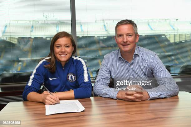Fran Kirby of Chelsea FC Women sits next to Paul Green as she signs a new contract lasting untill 2021at Stamford Bridge on May 31 2018 in London...