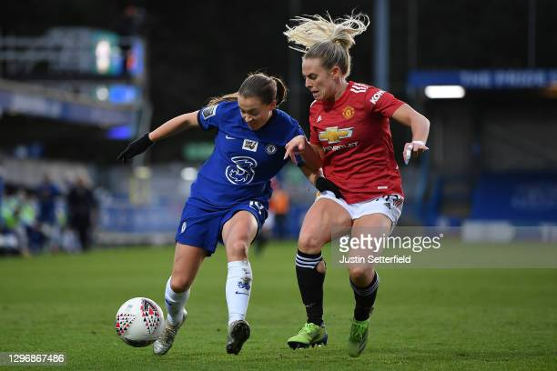 Fran Kirby of Chelsea is tackled by Kirsty Smith of Manchester United during the Barclays FA Women's Super League match between Chelsea Women and...
