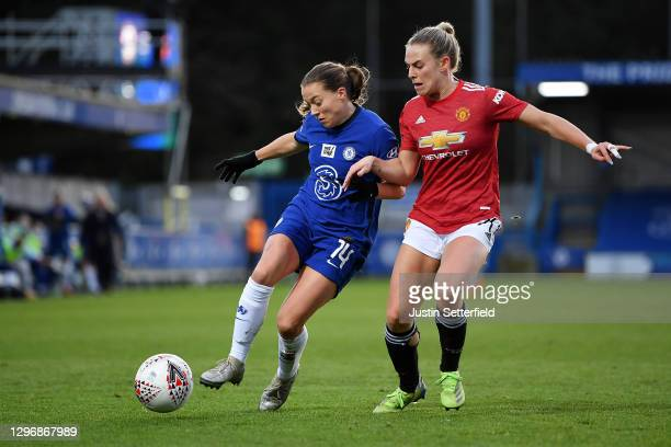 Fran Kirby of Chelsea looks to break past Kirsty Smith of Manchester United during the Barclays FA Women's Super League match between Chelsea Women...