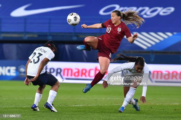 Fran Kirby of England battles for possession with Perle Morroni and Grace Geyoro of France during the International Friendly Match between France and...