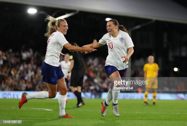 Fran Kirby of England celebrates after she scores the first goal with Toni Duggan during the International Friendly between England Women and...