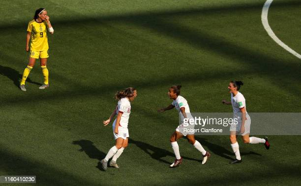 Fran Kirby of England celebrates with teammates after scoring her team's first goal during the 2019 FIFA Women's World Cup France 3rd Place Match...