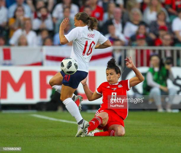 Fran Kirby of England Women is tackled by Angharad James of Wales Women during 2019 FIFA Women's World Cup Group 1 qualifier between Wales Women and...