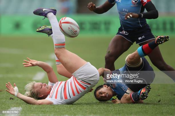 Fran Matthews of England passes as she is tackled during the Pool C match between the USA and England in the 2017 HSBC Sydney Sevens at Allianz...