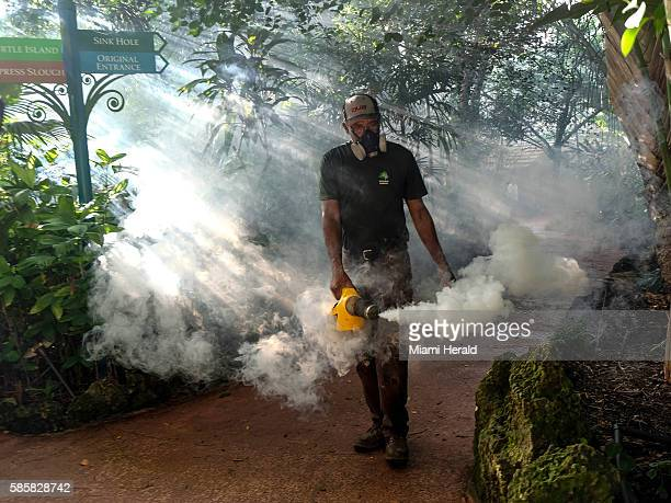Fran Middlebrooks a grounds keeper at Pinecrest Gardens former home of the historic Parrot Jungle uses a blower to spray pesticide to kill mosquitos...