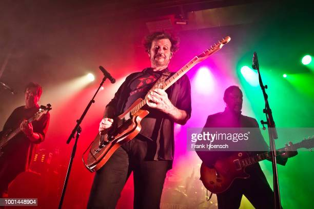 Fran Smith Jr Eric Bazilian and John Lilley of the American band The Hooters perform live on stage during a concert at the Columbia Theater on July...