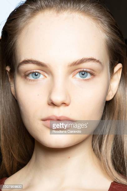 Fran Summers, make up detail, is seen backstage at the Salvatore Ferragamo fashion show on February 22, 2020 in Milan, Italy.