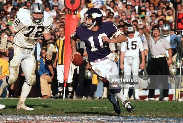 Fran Tarkenton of the Minnesota Vikings scrambles with the ball against the Oakland Raiders during Super Bowl XI on January 9, 1977 at the Rose Bowl...