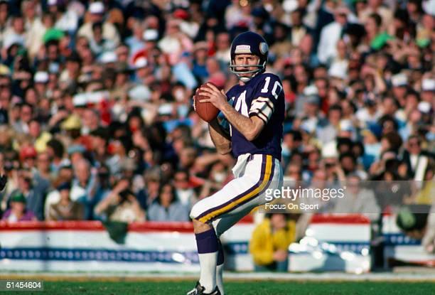 Fran Tarkenton quarterback for the Minnesota Vikings readies a pass during Super Bowl XI against the Oakland Raiders at the Rose Bowl on January 9...