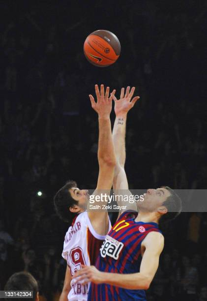 Fran Vazquez #17 of FC Barcelona regal and Furkan Aldemir #19 of Galatasaray Medical Park reaching for the first ball at the beginning of the...