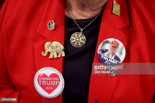 Fran Wesselt wears Donald Trump themed campaign pins on her jacket before Republican Presidential nominee Donald J. Trump spoke during a rally at the...