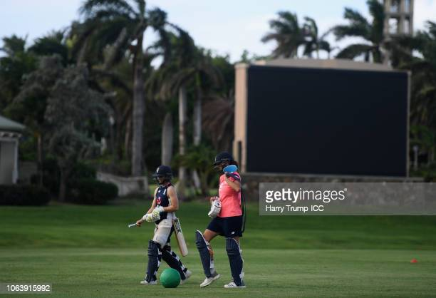 Fran WIlson and Jenny Gunn of England make their way off after having a bat in the nets during an England Nets Session at Coolidge Cricket Ground on...