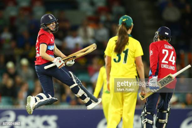 Fran Wilson of England celebrates after winning the Third Women's Twenty20 match between Australia and England at Manuka Oval on November 21 2017 in...