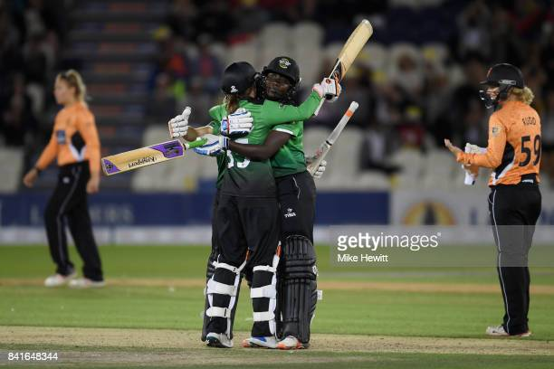 Fran Wilson Sophie Luff and Stafanie Taylor of Western Storm celebrates after winning the Women's Kia Super League Final between Southern Vipers and...