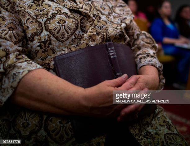 Fran Woolford holds a bible during a Pentecostal serpent handlers service at the House of the Lord Jesus church in Squire West Virginia on May 26...