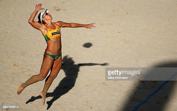Franca Larissa of Brazil serves during a match against Jennifer Kessy and Emily Day of the United Stateson September 30 2015 in Fort Lauderdale...
