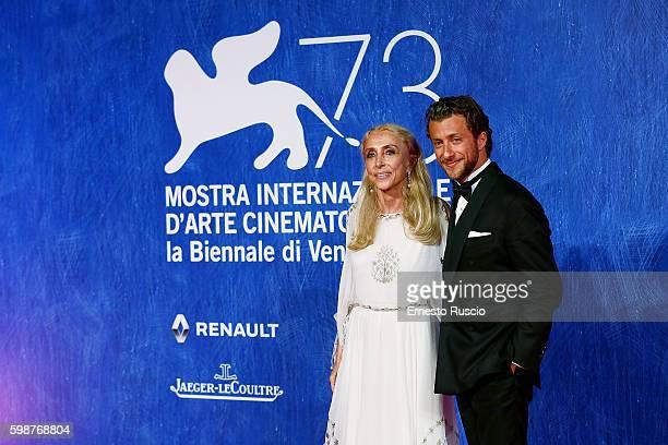 Franca Sozzani and Francesco Carrozzini attend the premiere of 'Franca Chaos And Creation' during the 73rd Venice Film Festival at Sala Giardino on...