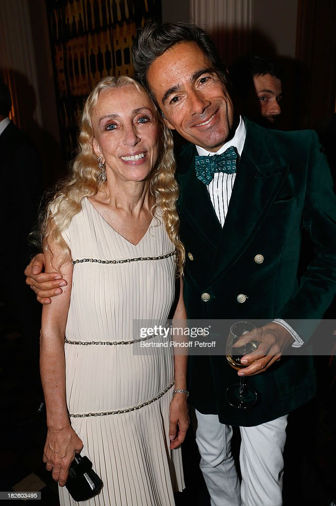 Franca Sozzani and Vincent Darre attend the Bulgari and Vogue Party at Apicius Restaurant as part of the Paris Fashion Week Womenswear Spring/Summer 2014 on September 28, 2013 in Paris, France.