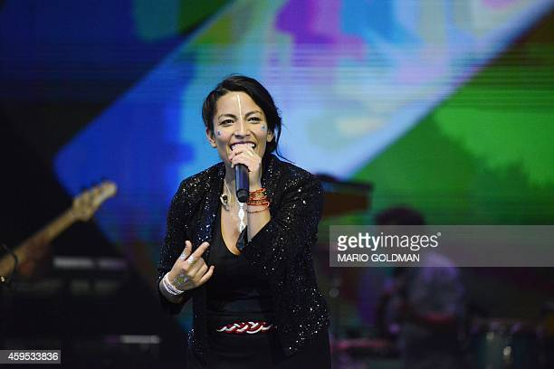 FrancChilean artist Ana Tijoux and her band perform during the Copa America 2015 football tournament draw at the Quinta Vergara in Vina del Mar Chile...