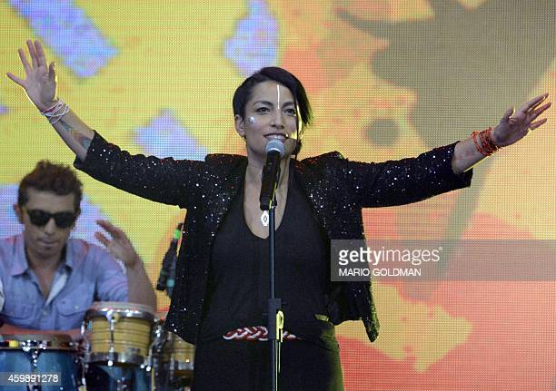 FrancChilean artist Ana Tijoux and her band perform during the opening of the Copa America 2015 draw at the Quinta Vergara in Vina del Mar Chile on...
