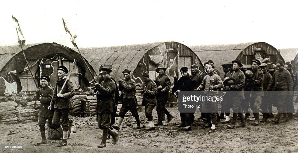 France, 2-11-1918, World War I, On the Canadian front, Chinese workers celebrate Chinese New Year with a joyous procession around the camp.