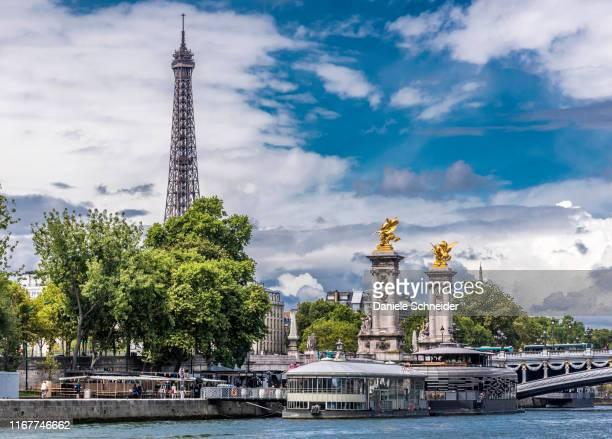 france, 7th arrondissement of paris, eiffel tower, pont alexandre iii over the seine river and rosa bonheur and flow barges-restaurant - pont alexandre iii photos et images de collection