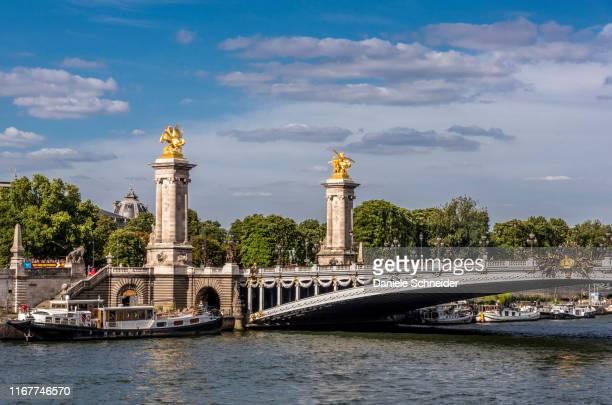 france, 8th arrondissement of paris, pont alexandre iii over the seine river and barges - pont alexandre iii photos et images de collection