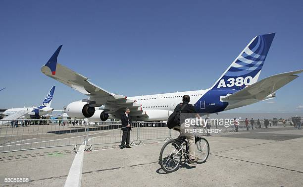 A man rides in front of of the Airbus A380 at Le Bourget airport 12 June 2005 An Airbus A380 aircraft landed for the first time at a Paris airport on...
