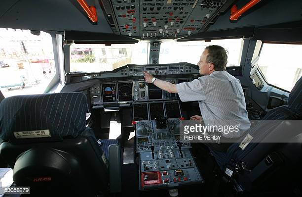 Airbus A380 pilot Jacques Rosay sits in the giant's cockpit at Le Bourget airport 12 June 2005 few minutes after the plane landed near Paris . An...
