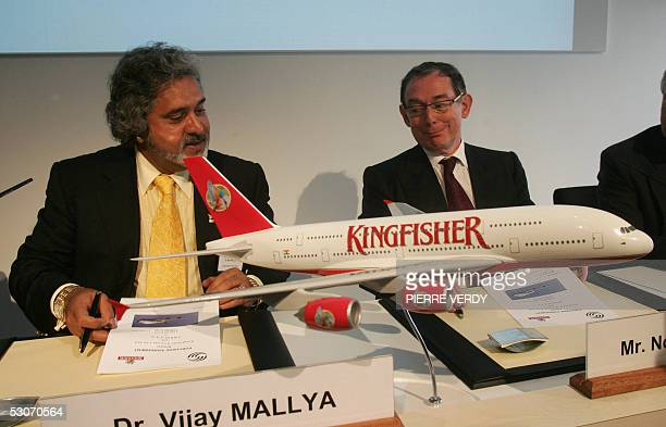 Airbus CEO Noel Forgeard and Indian UB group chairman Vijay Mallya smile after signing a contract 15 June 2005 in front of a model of Airbus A380 at...