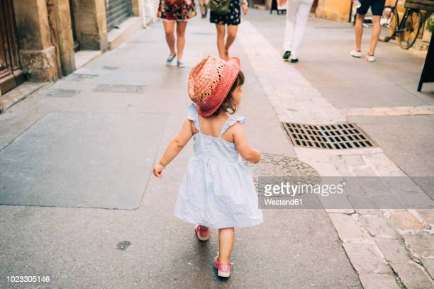 france, aix-en-provence, toddler girl walking down the streets of the city center - one baby girl only stock pictures, royalty-free photos & images