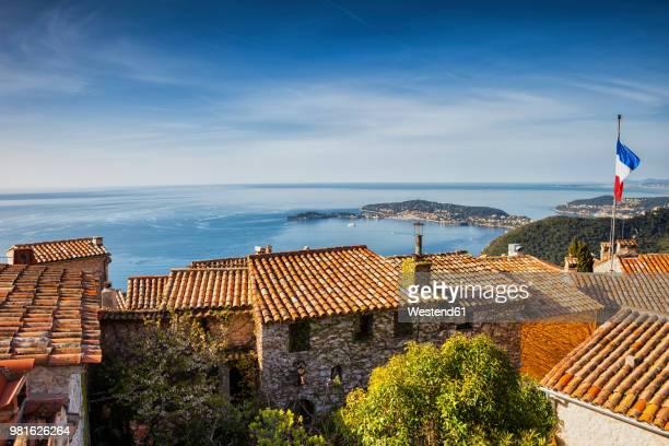 france, alpes maritimes, french riviera, cote d'azur, eze medieval village houses, view to mediterranean sea - eze village photos et images de collection