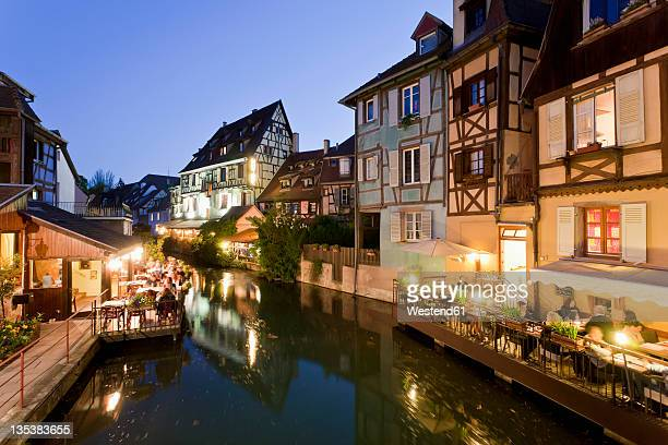 France, Alsace, Colmar, Krutenau, View of La Petite Venise quarters with restaurant near Lauch river at night
