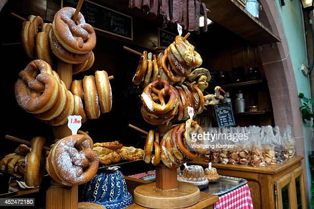 France Alsace Medieval Town Of Riquewihr Store Selling Pretzels Macarones And Kugelhopf