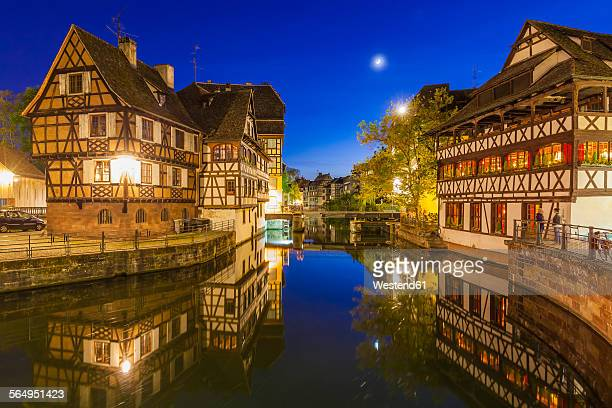 France, Alsace, Strasbourg, La Petite France, half-timbered houses, LIll river at night