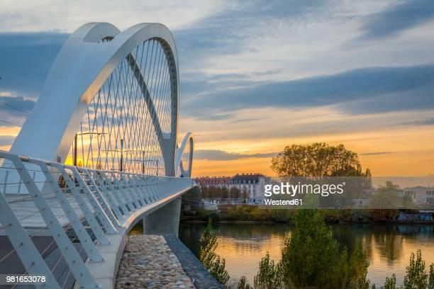France, Alsace, Strasbourg, Passerelle des Deux Rives at sunset
