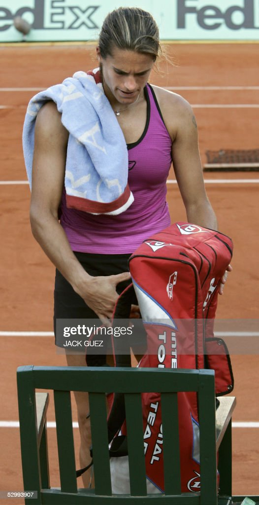 Amelie Mauresmo of France takes her bag before leaving the central court after loosing against Ana Ivanovic of Serbia for the third round match of the tennis French Open at Roland Garros, 28 May 2005 in Paris. Ivanovic won 6-4, 3-6, 6-4.
